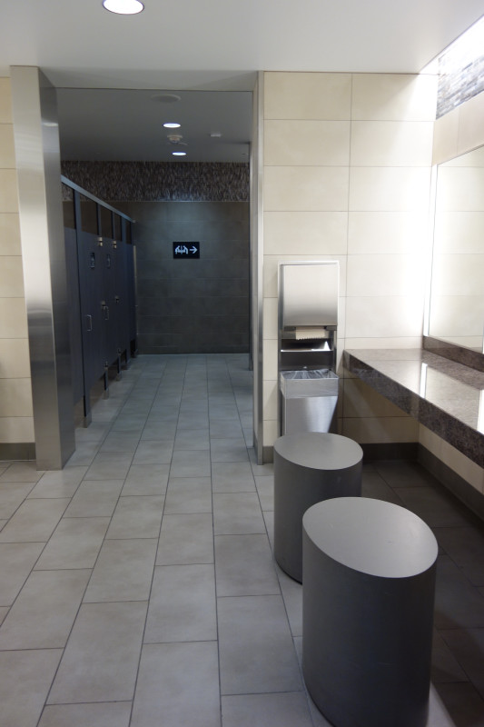 Indirect lighting and seating in women's washrooms - SFO T2